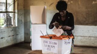 A Zambian woman gets ready to cast her ballot for the Zambian Presidential elections at Kanyama primary in Lusaka on January 20, 2015
