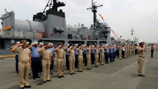 Filipino Navy officers and personnel salute as navy ship BRP Andres Bonifacio FF17 docked at a port in Manila, Philippines, 06 April 2017.
