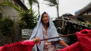 A Filipino elderly woman is seen in the typhoon-hit town of Aparri, Cagayan province, Philippines, 15 September 2018.