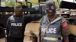Nigeria police officers wear mask go do raid