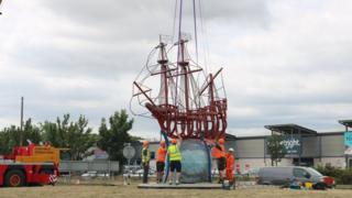The sculpture is placed on its globe base
