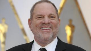 Harvey Weinstein poses on the Red Carpet after arriving at the 89th Academy Awards in Hollywood, California, February 26, 2017