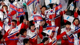 Athletes from North and South Korea together during the closing ceremony of the Winter Olympics