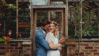 Married couple smile and hug for wedding photo