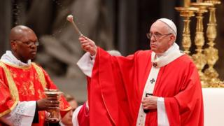 "Pope Francis sprinkles holy water during a Mass of Pentecost at Saint Peter""s Basilica at the Vatican, May 20, 2018."