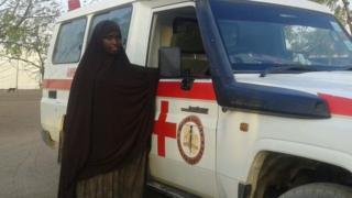 Bishara Farah stands next to her ambulance