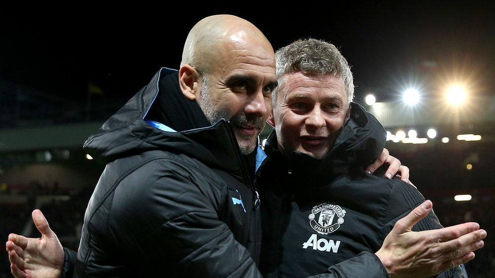 Pep Guardiola, Manager of Manchester City and Ole Gunnar Solskjaer, Manager of Manchester United embrace