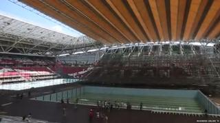 A view of the new swimming pools on the pitch and the temporary roof