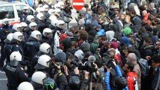 Police officers try to stop protesters on their way in the village of Brenner on the Italian-Austrian border, Sunday, 3 April 2016