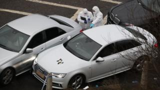Police forensics officers at the scene near J24 of the M62
