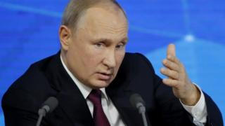 Russian President Vladimir Putin speaks during annual news conference in Moscow, Russia