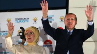 Turkey's President Recep Tayyip Erdogan and his wife Emine Erdogan greet supporters gathered at the AK Party headquarters in Ankara, Turkey