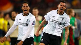 Virgil Van Dijk (L) and Dejan Lovren of Liverpool celebrate their semi final win at full time during the UEFA Champions League Semi Final Second Leg match