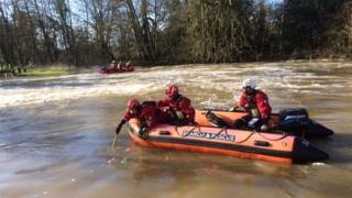 Divers on search and rescue boats