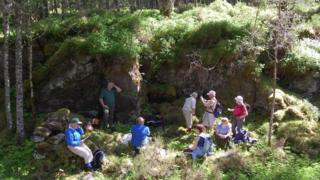 Walkers at the site of the illicit still in Glen Affric