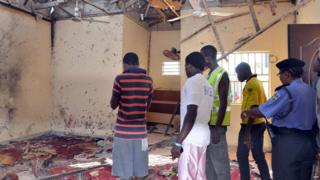 A picture taken on October 23, 2015 in Maiduguri, northeast Nigeria, shows people standing in a mosque following a suicide bombing