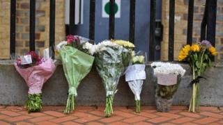 in_pictures Floral tributes are seen at a police cordon at the Abbey Gateway near Forbury Gardens park in Reading