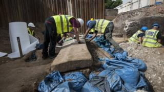 The sarcophagus is unearthed