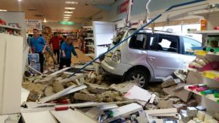 The scene inside the shop where the car crashed