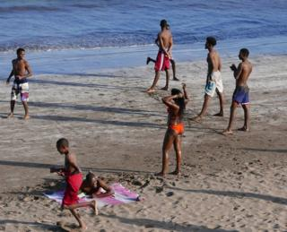 Youngsters playing on a beach in Cape Verde.