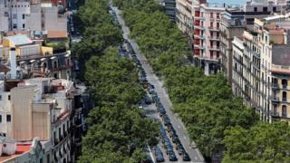 Hundreds of parked taxi vehicles occupy the Gran Via avenue in downtown Barcelona, north-eastern Spain, 29 July 2018