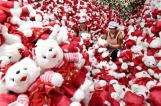 Workers make stuffed toys for export inside a factory in Linyi, Shandong province, China on 26 June 2018.