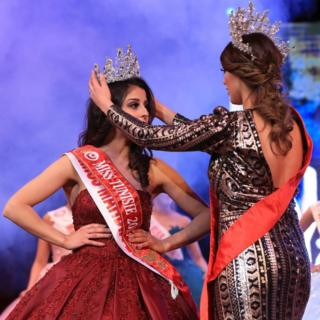 Sabrine Khalifa Mansour (L) is crowned Miss Tunisia 2019 during the beauty pageant held in Tunis, Tunisia, on 9 February 2019.
