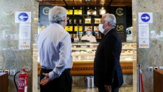 Antonio Costa (R) during breakfast at a pastry shop in Lisbon
