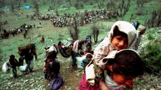 Kurdish refugees fleeing near the Iraqi-Turkish border in April 1992