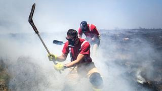 Firefighters tackling the fire at Winter Hill