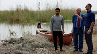 Laith Al-Rubaiy talking to local people in the marshlands