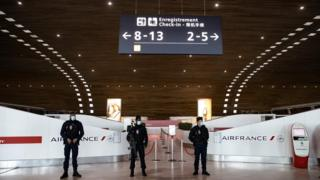 French police officers in Charles de Gaulle international airport in France during the coronavirus pandemic