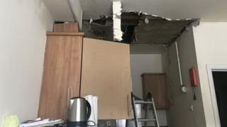A kitchen ceiling has collapsed after flooding.