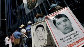 "Relatives hold poster with images of some of the 43 missing students of Ayotzinapa College Raul Isidro Burgos as they take part in a protest to demand the removal of Director of Criminal Investigations,Tomas Zeron, outside the Attorney General""s Office (PGR) headquarters in Mexico City, Mexico May 20, 2016."