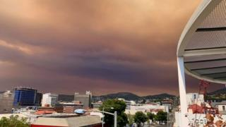 Smoke-filled red clouds blanket the city of Hobart