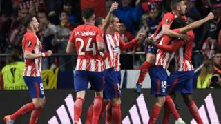 Atletico players celebrate the opening goal during the UEFA Europa League semi-final second leg football match between Club Atletico de Madrid and Arsenal FC at the Wanda Metropolitano stadium in Madrid on May 3, 2018