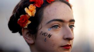 A woman attends a rally against gender-based and sexual violence against women in Marseille, France, November 24, 2018.