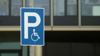 A disability parking sign