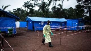 A health worker walks in an Ebola quarantine unit in the DR Congo