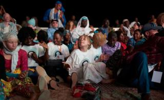 Children watching the concert with Salif Keita