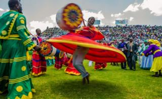 Zimbabwean worshippers and congregants from various indigenous church denominations perform and dance as they wait to be addressed by Zimbabwe first lady Grace Mugabe (not in picture) at a religious gathering rally organised by Zimbabwean ruling party Zimbabwe African National Union- Patriotic Front (Zanu PF) Harare Youth Province on 5 November