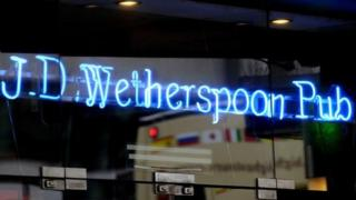 a neon sign in a JD Wetherspoon pub in London
