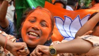"An Indian supporter of Bharatiya Janata Party (BJP) dances as she celebrates on the vote results day for India""s general election in Siliguri."