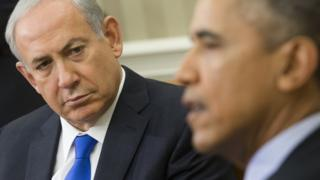 Benjamin Netanyahu looks at Barack Obama during a meeting at the White House on 9 November 2015