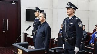 "This handout photo taken on January 21, 2020 and released by the Tianjin First Intermediate People""s Court shows former Interpol chief Meng Hongwei in court"