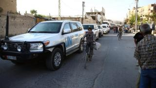 UN and Syrian Arab Red Crescent vehicles deliver aid to rebel-held Damascus suburb of Douma (10 June 2016)