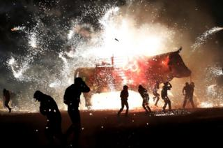 People enjoy fireworks exploding from a traditional bull known as Torito during the annual celebration of San Juan de Dios festivity in Tultepec, on the outskirts of Mexico City, Mexico, 8 March 2017.