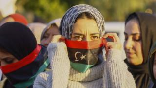 Demonstrators take part in a rally against eastern Libyan strongman Khalifa Haftar