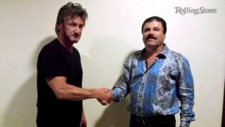 """Actor Sean Penn (left) shakes hands with Mexican drug lord Joaquin """"El Chapo"""" Guzman in Mexico, in this undated Rolling Stone handout photo obtained by Reuters on January 10, 2016."""