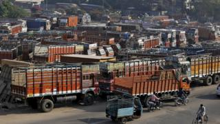 Trucks are seen parked in an open plot near a national highway on the outskirts of Ahmedabad, India, December 2, 2015.